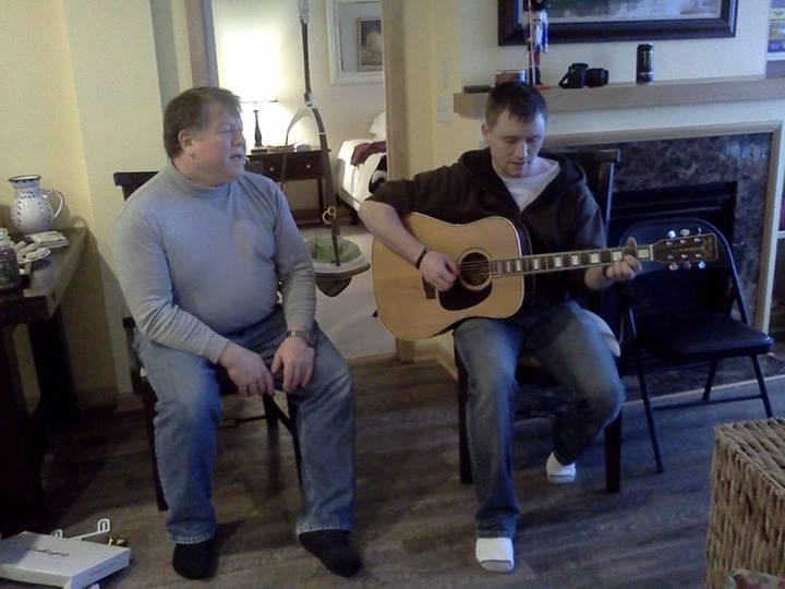 David and his dad singing Christmas carols