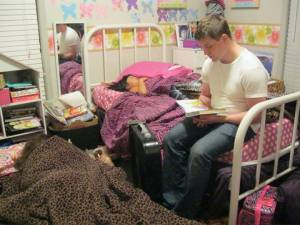 David reading to his little sisters