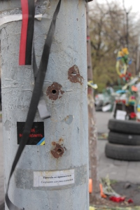 Bullet-holes in a telephone pole.